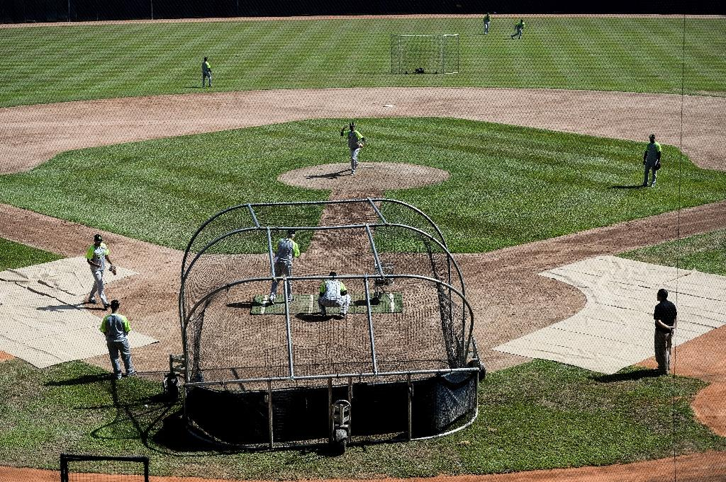 President Nicolas Maduro is making $10 million available to the Venezuelan Professional Baseball League but the move has angered many who believe the money should go to help alleviate shortages caused by the deep economic and political crisis (AFP Photo/FEDERICO PARRA)