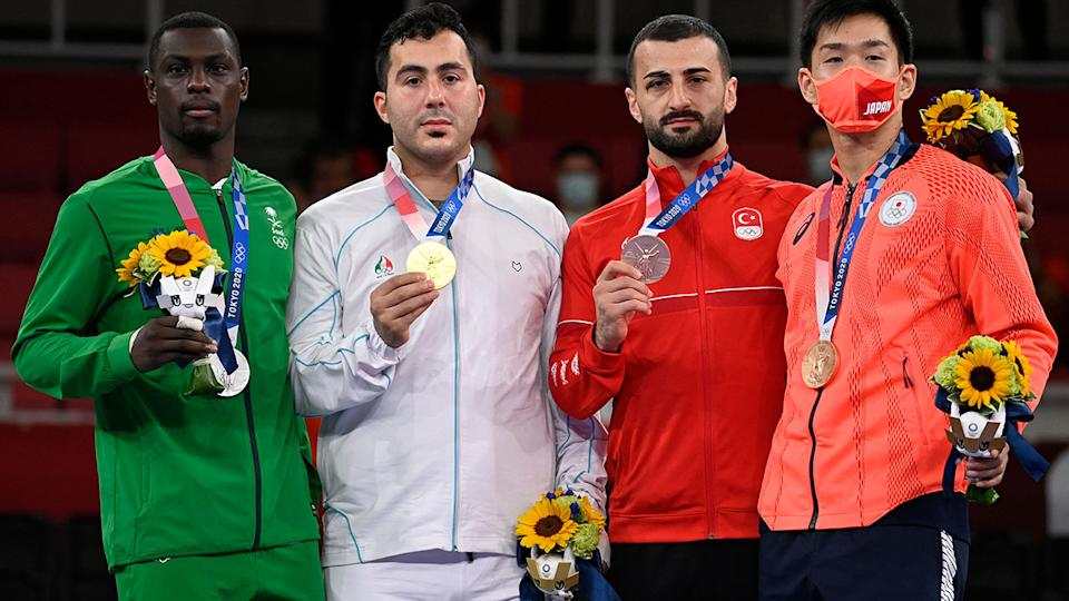 Tareg Hamedi and Sajad Ganjzadeh, pictured here with their medals after the karate gold medal match.