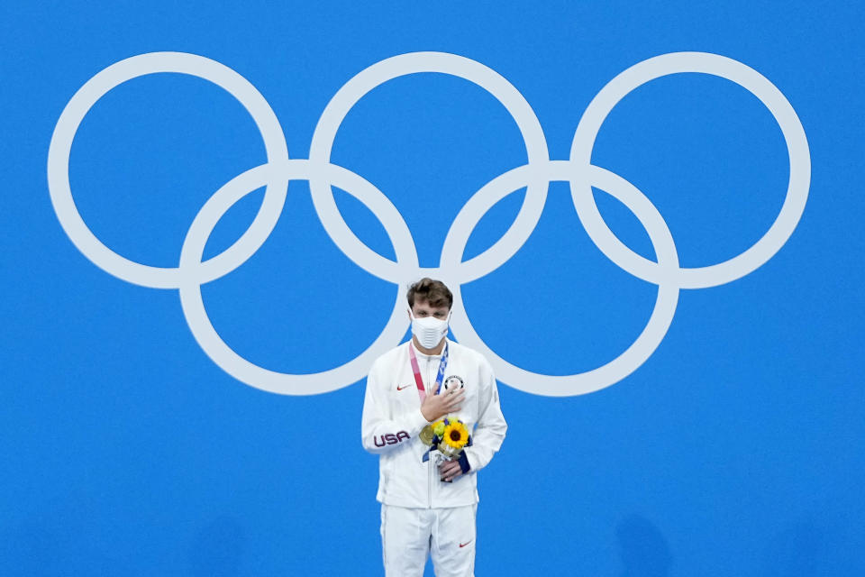 Robert Finke, of the United States, receives his gold medal in the men's 1500-meter freestyle final at the 2020 Summer Olympics, Sunday, Aug. 1, 2021, in Tokyo, Japan. (AP Photo/Jeff Roberson)
