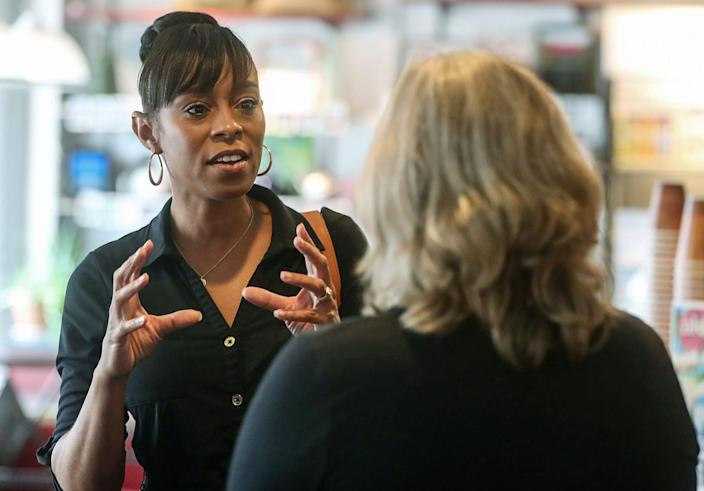 Shontel Brown, a candidate vying to represent Ohio's 11th Congressional District, talks with Nancy Holland, Akron city council ward 1, at Angel Falls Coffee shop during a campaign stop in Akron on July 14, 2021. (Mike Cardew / Akron Beacon Journal file)