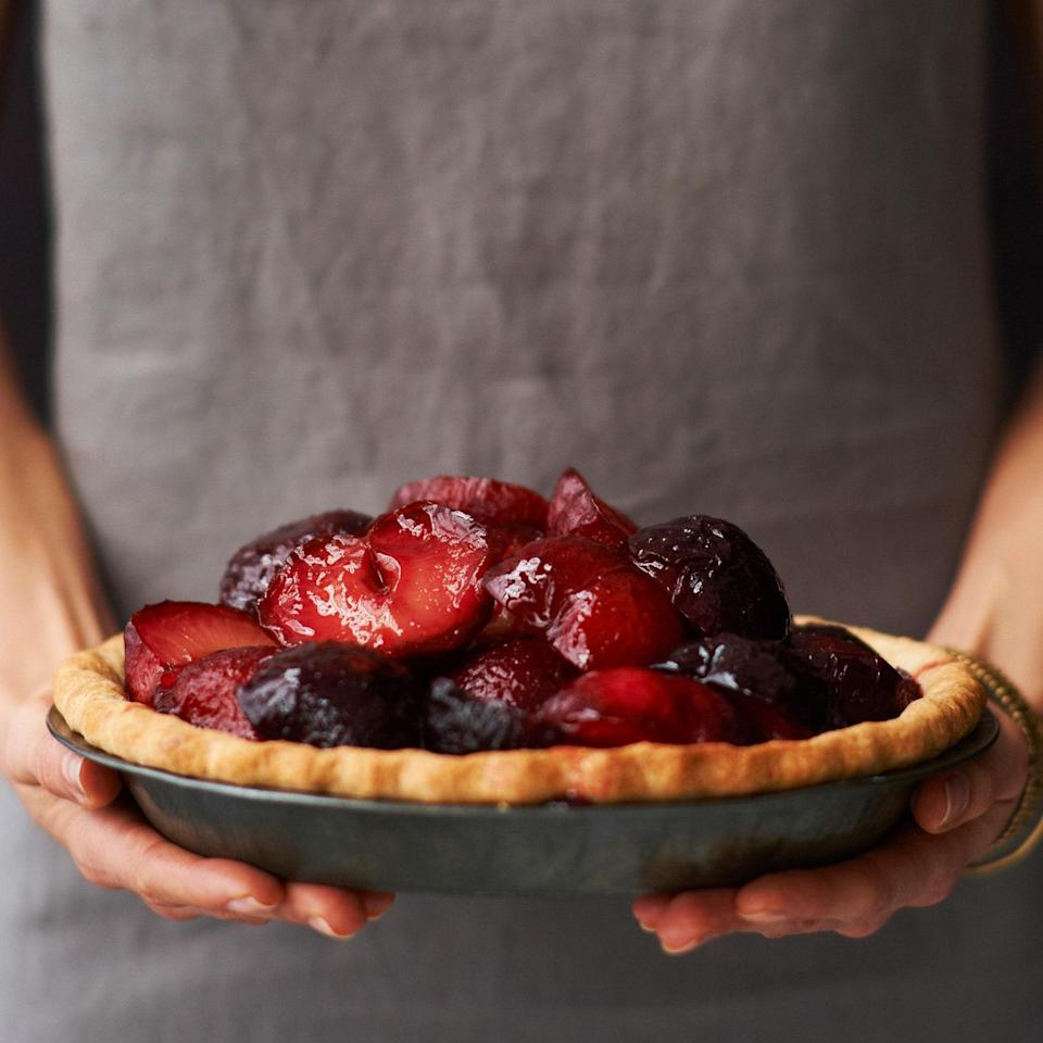 """Creamy honey-sweetened mascarpone is a welcome surprise under the mound of plums. <a href=""""https://www.epicurious.com/recipes/food/views/plum-and-mascarpone-pie-51108270?mbid=synd_yahoo_rss"""" rel=""""nofollow noopener"""" target=""""_blank"""" data-ylk=""""slk:See recipe."""" class=""""link rapid-noclick-resp"""">See recipe.</a>"""