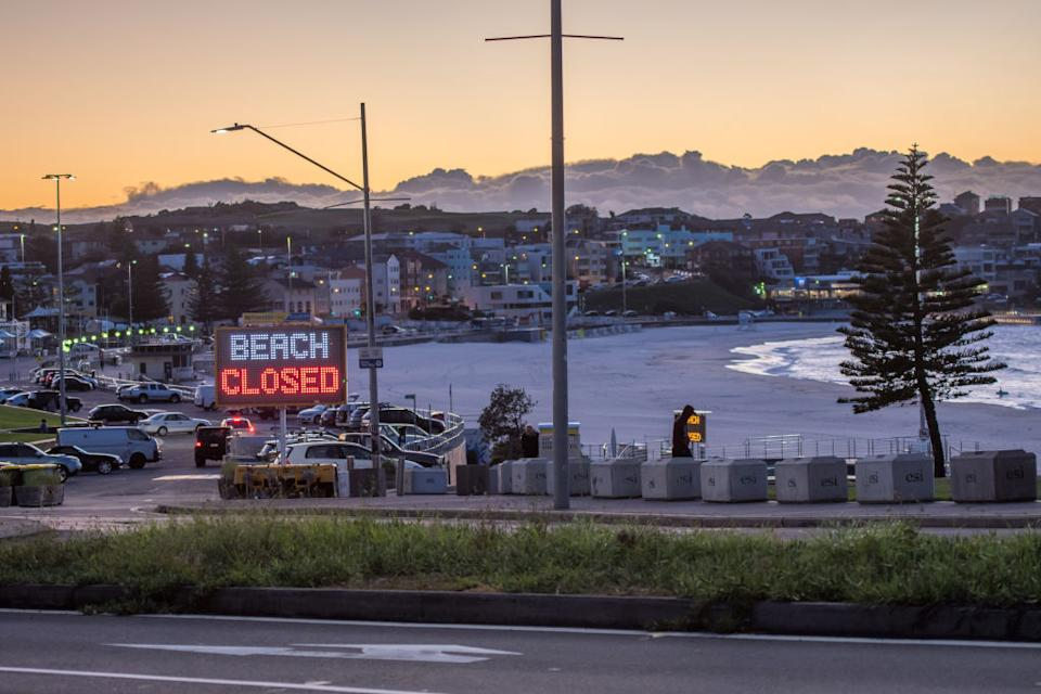 An electronic sign board showing ''Beach closed '' in early hours on Bondi Beach.