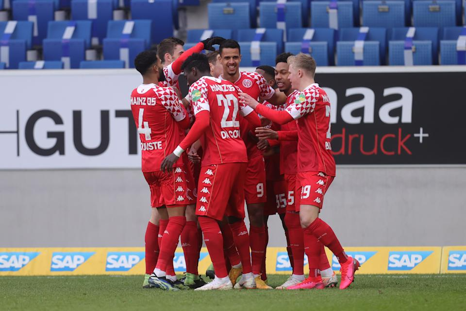 SINSHEIM, GERMANY - MARCH 21: Robert Glatzel of 1. FSV Mainz 05 celebrates their sides first goal with team mates Jeremiah St. Juste and Danny da Costa during the Bundesliga match between TSG Hoffenheim and 1. FSV Mainz 05 at PreZero-Arena on March 21, 2021 in Sinsheim, Germany. Sporting stadiums around Germany remain under strict restrictions due to the Coronavirus Pandemic as Government social distancing laws prohibit fans inside venues resulting in games being played behind closed doors. (Photo by Alex Grimm/Getty Images)