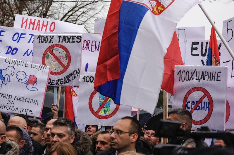 Kosovo Serbs take part in a protest in the northern town of Mitrovica in November 2018, following Kosovo's move to slap Serbian imports with a 100 percent tariff