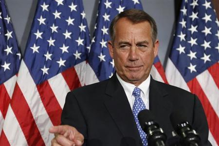 U.S. House Speaker Boehner calls on a reporter during a news conference in Washington