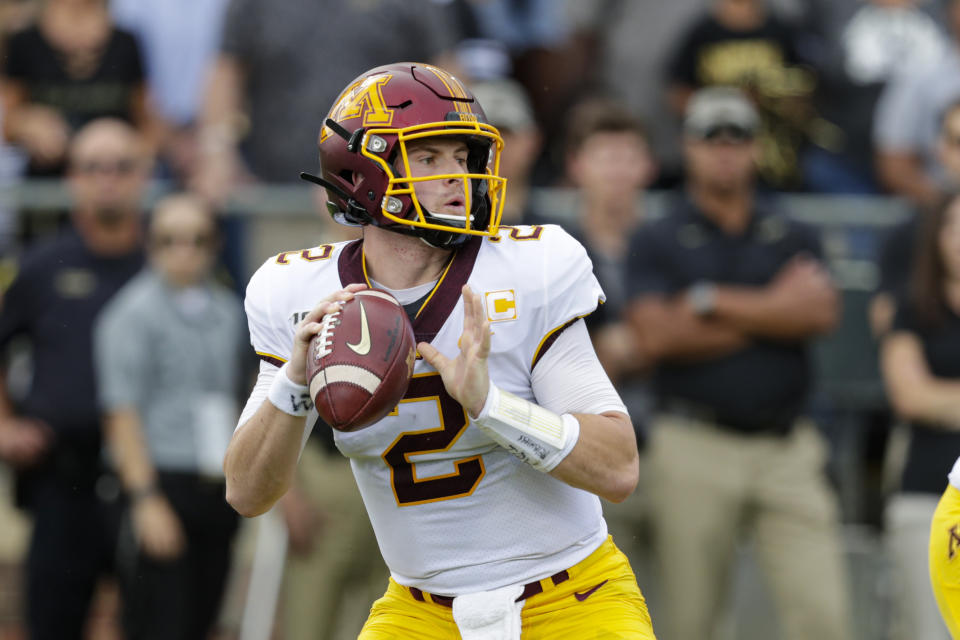 Minnesota quarterback Tanner Morgan (2) throws against Purdue during the first half of an NCAA college football game in West Lafayette, Ind., Saturday, Sept. 28, 2019. (AP Photo/Michael Conroy)