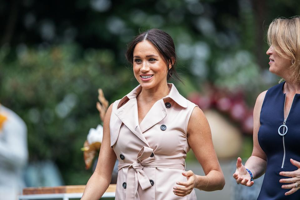 Meghan, the Duchess of Sussex(L) arrives at the British High Commissioner residency in Johannesburg where she  will meet with Graca Machel, widow of former South African president Nelson Mandela, in Johannesburg, on October 2, 2019. - Prince Harry recalled the hounding of his late mother Diana to denounce media treatment of his wife Meghan Markle, as the couple launched legal action against a British tabloid for invasion of privacy. (Photo by Michele Spatari / AFP) (Photo by MICHELE SPATARI/AFP via Getty Images)