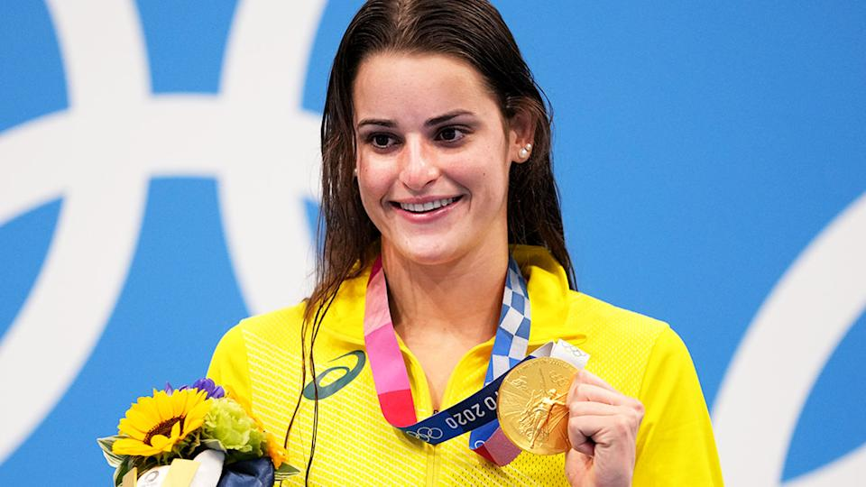 Kaylee McKeown is pictured here on the podium in Tokyo with her gold medal.