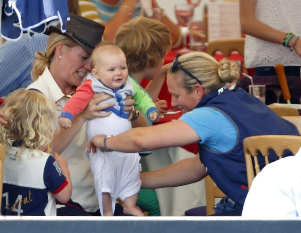 """<p>Mia, 7 months, gets changed by her mother Zara Phillips and aunt Autumn at the Festival of British Eventing. Mia, granddaughter of Queen Elizabeth II, <a href=""""https://www.cosmopolitan.com/entertainment/celebs/a21615062/zara-tindall-royal-baby-girl/"""" rel=""""nofollow noopener"""" target=""""_blank"""" data-ylk=""""slk:welcomed a sister in June 2018"""" class=""""link rapid-noclick-resp"""">welcomed a sister in June 2018</a> and a <a href=""""https://www.townandcountrymag.com/society/tradition/a35924843/zara-tindall-gives-birth-lucas-philip-tindall/"""" rel=""""nofollow noopener"""" target=""""_blank"""" data-ylk=""""slk:brother in March 2021"""" class=""""link rapid-noclick-resp"""">brother in March 2021</a>. </p>"""