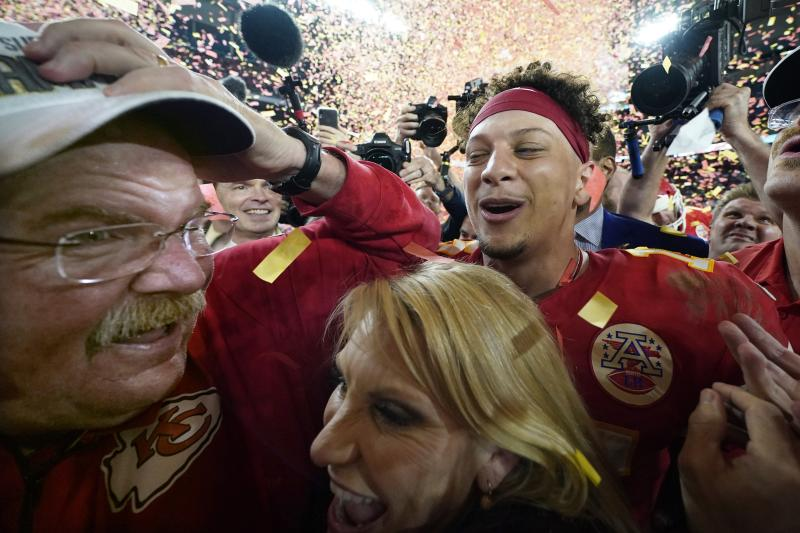 Kansas City Chiefs head coach Andy Reid, left, his wife Tammy Reid, center, and quarterback Patrick Mahomes celebrate after the Chiefs defeated the San Francisco 49ers in the NFL Super Bowl 54 football game Sunday, Feb. 2, 2020, in Miami Gardens, Fla. (AP Photo/David J. Phillip)