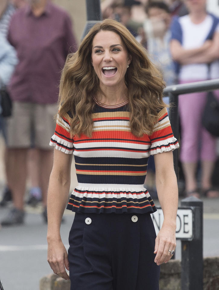"Kate arrives in Cowes <a href=""https://uk.style.yahoo.com/kate-middleton-sandro-top-kings-cup-115100067.html"">wearing a Sandro striped top</a> and LK Bennett trousers. <em>[Photo: Getty]</em>"