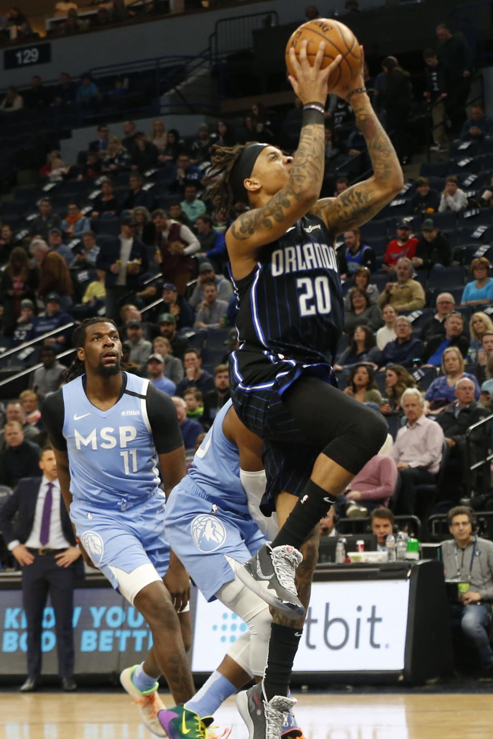 Orlando Magic's Markelle Fultz, right, lays up as Minnesota Timberwolves' D'Angelo Russell watches in the first half of an NBA basketball game, Friday, March 6, 2020, in Minneapolis. (AP Photo/Jim Mone)