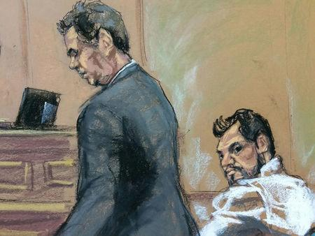 Mehmet Hakan Atilla (R) a deputy general manager of Halkbank, is shown in this court room sketch with his attorney Gerald J. DiChiara as he appears in Manhattan federal court in New York