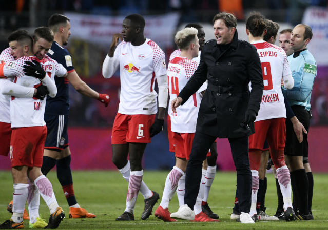 Leipzig's head coach Ralph Hasenhuettl, center right, celebrates with his team during the German first division Bundesliga soccer match between RB Leipzig and FC Bayern Muenchen in Leipzig, Germany, Sunday, March 18, 2018. Leipzig won by 2-1. (AP Photo/Jens Meyer)