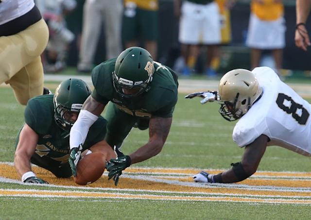 Baylor defensive end Jamal Palmer, center, pulls in a fumble past Wofford running back Donovan Johnson (8) and teammate Bryce Hager, left, during the first half of a NCAA college football game on Saturday, Aug. 31, 2013, in Waco, Texas. (AP Photo/Waco Tribune Herald, Rod Aydelotte)