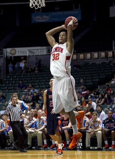 Clemson's K.J. McDaniels goes up for a dunk against UTEP during the first half of the NCAA college basketball game at the Stan Sheriff Center Thursday, Dec. 22, 2011 in Honolulu. (AP Photo/Marco Garcia)