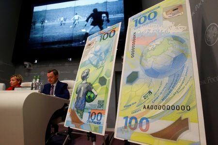 FILE PHOTO: Russian central bank deputy chairwoman Olga Skorobogatova and General Director of Goznak state firm Arkady Trachuk attend a news conference unveiling the newly designed 100-rouble banknote dedicated to the 2018 FIFA World Cup, in Moscow, Russia May 22, 2018. REUTERS/Sergei Karpukhin/File Photo