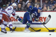 New York Rangers' Brendan Smith, left, checks Vancouver Canucks' Tanner Pearson during the third period of an NHL hockey game Wednesday, March 13, 2019, in Vancouver, British Columbia. (Darryl Dyck/The Canadian Press via AP)