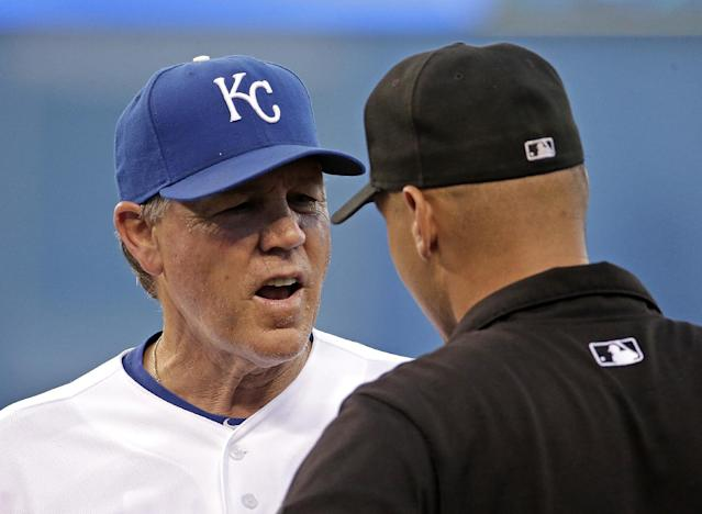 Kansas City Royals manager Ned Yost talks to an umpire during the fifth inning of a baseball game against the Detroit Tigers on Friday, July 11, 2014, in Kansas City, Mo. (AP Photo/Charlie Riedel)