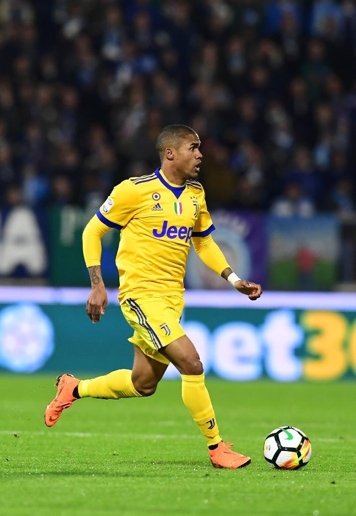 With Neymar out, Brazil coach Tite is entrusting the left wing to Juventus's in-form Douglas Costa (AFP Photo/MIGUEL MEDINA)