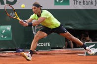 Spain's Rafael Nadal reaches the ball as he plays Serbia's Novak Djokovic rduring their semifinal match of the French Open tennis tournament at the Roland Garros stadium Friday, June 11, 2021 in Paris. (AP Photo/Michel Euler)