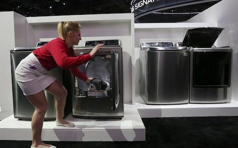 """China and South Korea have criticised new tariffs on imported washing machines and solar panelsas part ofDonald Trump's """"America First"""" trade policy. The tariffs, announced late on Monday, aim to protect US manufacturers from foreign competition, but opponents fear they could mark the opening salvo in a trade war if the Asian nations respond in kind. The move may constitute a""""violation of WTO provisions,""""said South Korean trade minister Kin Hyuan-chong. Adding tocriticism from environmentalists, who say increasing the cost of solar panels will stunt renewable energy uptake in the US, China's government spokesman Way Hejun expressed """"strongdissatisfaction"""" with the move. """"Together with other WTO members, China will resolutely defend its legitimate interests,""""he said. The new duties will mainly effect washing machine producers in South Korea and solar panel manufacturers in China. An exhibitor demonstrating an Inverter Direct Drive washing machine at the LG exhibit during the 2016 Consumer Electronics Show in Las Vegas Credit: DAVID MCNEW/AFP The tax on solar panels is not as high as US manufactures had hoped, set at 30 per cent for the first year and falling to 15 per cent by the fourth. However, 2.5 gigawatts of cells will be allowed into America tariff-free each year. Meanwhile, the first 1.2 million imported residential washing machines will see a 20 per cent duty in the first year, with all imports above that number slapped with a tax of 50 per cent. The figures will drop to 16 per cent and 40 per cent respectively by the third year. South Korea, whose washing machine manufacturers include Samsung and LG, called the duties """"excessive"""" and threatened to complain to the World Trade Organization (WTO). The US is by far the most protectionist when it comes to global trade American manufacturers, who have for long campaigned for protection against cheap foreign imports,welcomed the news. Jeff Fettig, chairman of US washing machine makers Whirlpool, said,""""This announce"""