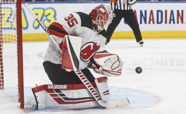 FILE - In this Nov. 8, 2019, file photo, New Jersey Devils' goalie Cory Schneider (35) makes a save during the second period of an NHL hockey game against the New Jersey Devils on Friday, Nov. 8, 2019, in Edmonton, Alberta. Veteran goaltender Schneider, who has been one of the main faces for the Devils organization in recent years, has been placed on waivers. (Jason Franson/The Canadian Press via AP, File)