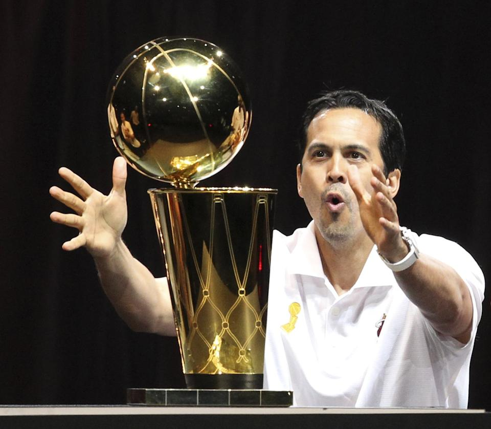 Head coach Erik Spoelstra of the Miami Heat reaches for the championship trophy as the team celebrates its second consecutive title with a parade on Monday, June 24, 2013, in Miami, Florida. (Charles Trainor Jr./Miami Herald/Tribune News Service via Getty Images)