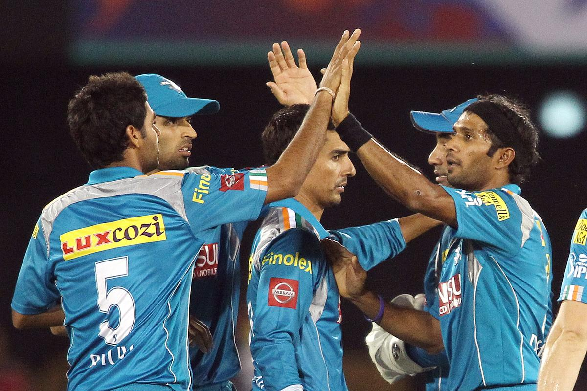 Ashok Dinda of Pune Warriors India is congratulated by Bhuvneshwar Kumar of Pune Warriors India for getting Virender Sehwag of Delhi Daredevils wicket during match 39 of the Pepsi Indian Premier League between The Delhi Daredevils and the Pune Warriors India held at the Chhattisgarh International Cricket Stadium in Raipur on the 28th April 2013. (BCCI)