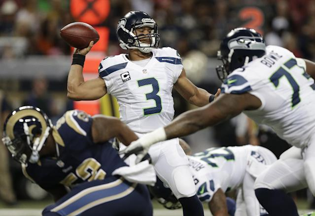 Seattle Seahawks quarterback Russell Wilson (3) works against the St. Louis Rams during the first half of an NFL football game, Monday, Oct. 28, 2013, in St. Louis. (AP Photo/Michael Conroy)