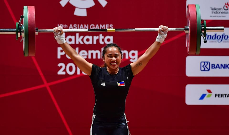 Hidilyn Diaz of Philippines competes in the women's 53kg weightlifting event during the 2018 Asian Games in Jakarta on August 21, 2018. (Photo by MONEY SHARMA / AFP)        (Photo credit should read MONEY SHARMA/AFP via Getty Images)