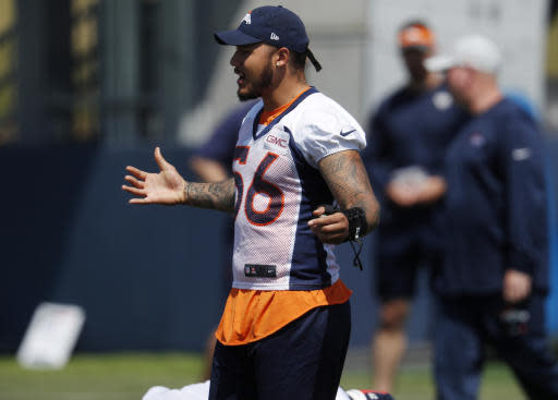 Denver Broncos linebacker Shane Ray, who is injured, jokes with teammates as they take part in drills during practice at the NFL football team's headquarters Tuesday, June 12, 2018, in Englewood, Colo. (AP Photo/David Zalubowski)