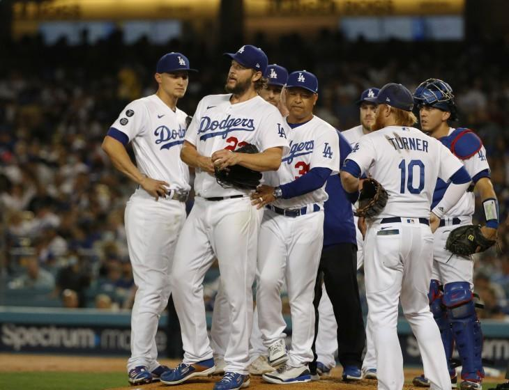 LOS ANGELES, CA - OCTOBER 1, 2021: Los Angeles Dodgers manager Dave Roberts (30) removes.