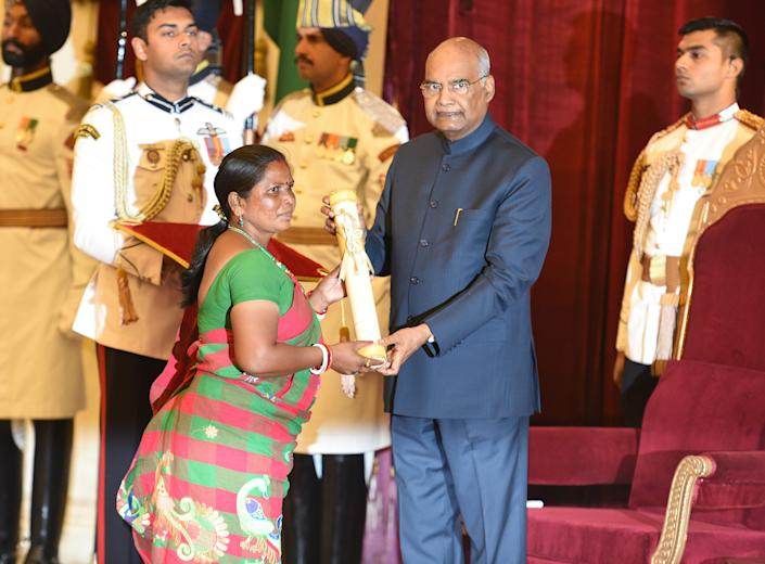 NEW DELHI, INDIA - MARCH 11: President Kovind presents Padma Shri to Jamuna Tudu for Social Work during Padma Awards 2019, at Rashtrapati Bhavan on March 11, 2019 in New Delhi, India. An environmental activist, she has been working towards conserving the jungles of Jharkhand for close to two decades. (Photo by Raj K Raj/Hindustan Times via Getty Images)
