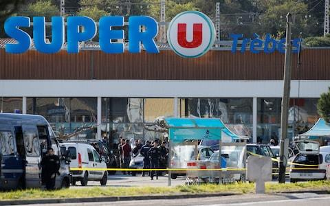 Gendarmes and police officers at a supermarket after a hostage situation in Trebes - Credit: REUTERS