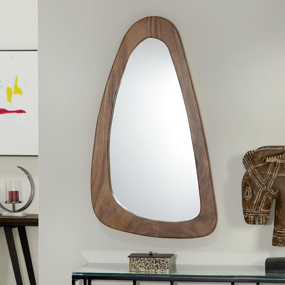 <p>This <span>Ayala Wood Accent Mirror</span> ($450) is a statement piece.</p>