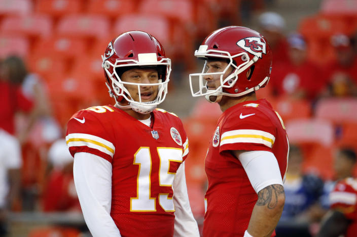 FILE - Kansas City Chiefs quarterback Chad Henne, right, chats with quarterback Patrick Mahomes (15) before an NFL preseason football game against the Green Bay Packers in Kansas City, Mo., in this Thursday, Aug. 30, 2018, file photo. If Patrick Mahomes is unable to play in the AFC title game following his concussion, the Chiefs have the utmost confidence in Chad Henne. After all, the 35-year-old journeyman already proved he could rise to the occasion on Sunday, helping Kansas City hold off the Cleveland Browns in the divisional round of the playoffs. (AP Photo/Charlie Riedel, FIle)
