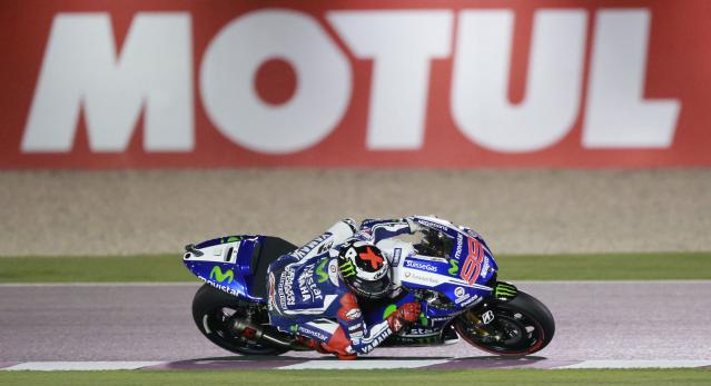 Yamaha MotoGP rider Jorge Lorenzo of Spain races during a free practice session at the MotoGP World Championship at the Losail International circuit in Doha March 22, 2014. REUTERS/ Mohammed Dabbous (QATAR - Tags: SPORT MOTORSPORT)