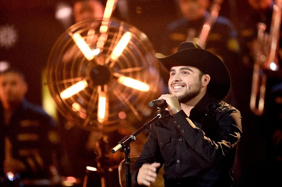 """""""Fuiste Mia"""", a slick music video by the Mexican-American singer Gerardo Ortiz, (pictured) has garnered more than 25 million views on YouTube and provoked a furious backlash (AFP Photo/Kevin Winter)"""