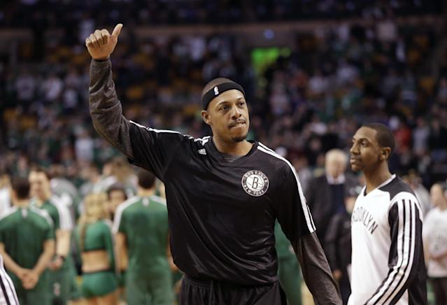 Brooklyn Nets forward Paul Pierce, formerly of the Boston Celtics, acknowledges applause from the crowd while warming up before an NBA basketball game against the Celtics, Sunday, Jan. 26, 2014, in Boston. (AP Photo/Steven Senne)