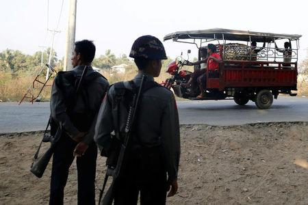 Myanmar policemen stand in a check point outside Rohingya refugee camp in Sittwe, Myanmar