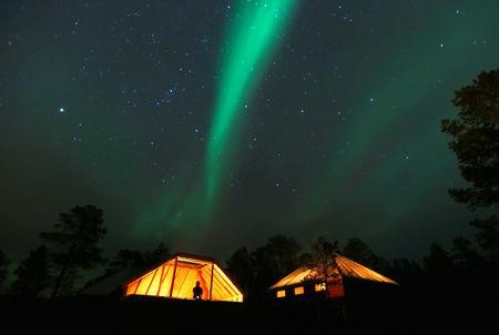 FILE PHOTO: The Aurora Borealis (Northern Lights) is seen over a mountain camp north of the Arctic Circle, near the village of Mestervik late October 1, 2014. Picture taken October 1, 2014. REUTERS/Yannis Behrakis/File Photo