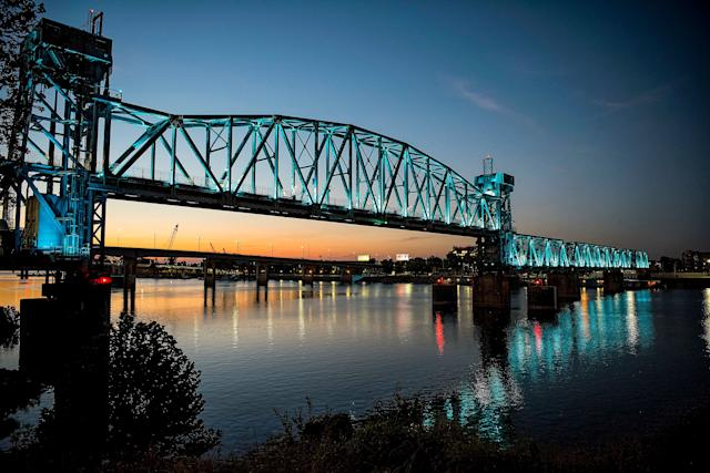The Junction Bridge illuminated during the evening hours. The bridge changed colors from time to time.