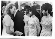 <p>British royalty meets music royalty: 18-year-old Anne greets the Supremes after a benefit performance at London's Palladium.<br></p>