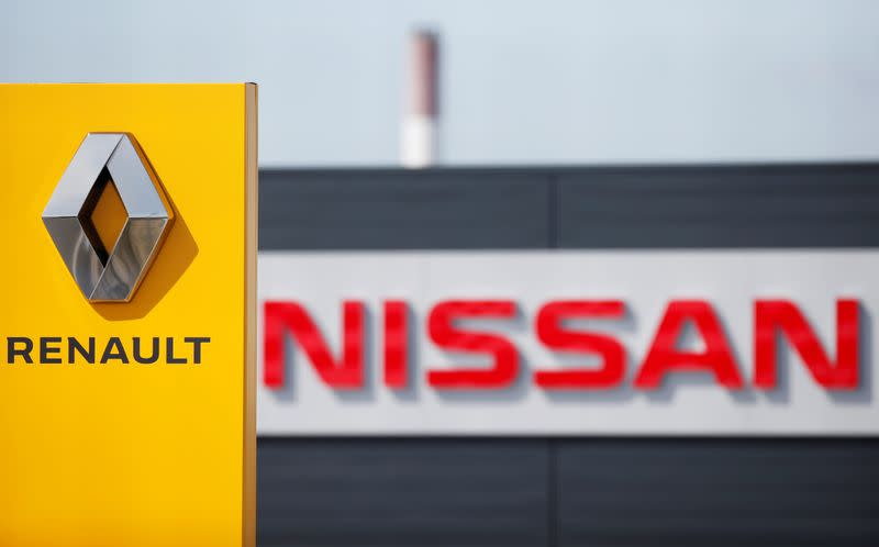 FILE PHOTO: The logos of car manufacturers Renault and Nissan are seen in front of dealerships of the companies in Reims