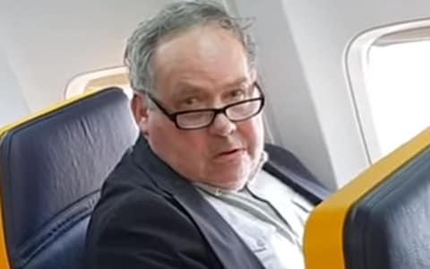 Ryanair passenger (pictured) filmed racially abusing woman on flight is identified by police - Credit: David Lawrence/PA