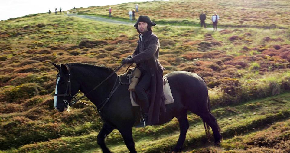 <p>Aidan Turner rides over heathland on Gwennap Head on the Cornish coast during filming for series three of the BBC One hit Sunday night drama Poldark. (Tom Leese/PA Wire) </p>