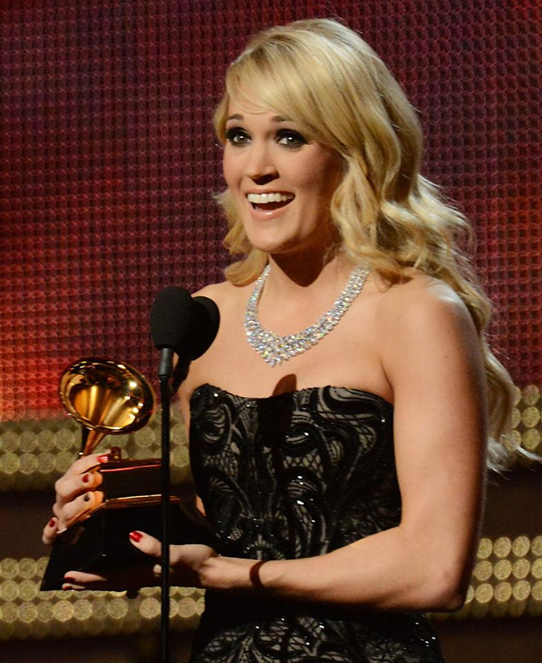 Carrie Underwood accepts an award onstage at the 55th Annual Grammy Awards at the Staples Center in Los Angeles, CA on February 10, 2013.