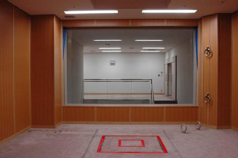 In this photo taken and released on Aug. 27, 2010 by Japan's Justice Ministry, the trapdoor where a condemned criminal is to stand is marked with a red double square on the floor in an execution room at Tokyo Detention Center when the local media are allowed a rare tour of Tokyo's main gallows in a bid to create more public awareness about capital punishment. Three death row inmates in Japan were executed by hanging on Thursday, March 29, 2012, the country's first executions in more than a year and a half. Japan, along with the United States, is one of the few industrialized countries that still has capital punishment. The room behind the glass window is for witnesses to stand and observe the execution. (AP Photo/Justice Ministry) EDITORIAL USE ONLY, NO CROPPING ALLOWED
