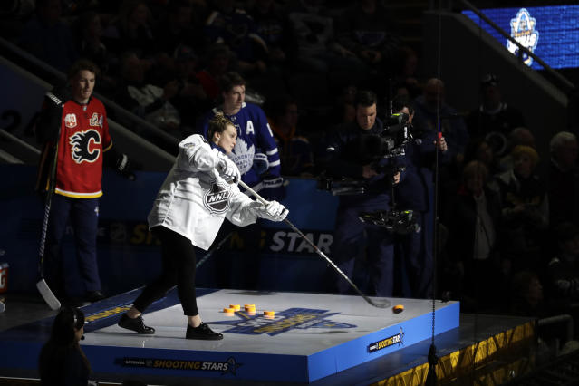 Canada's Marie-Philip Poulin shoots during the Skills Competition shooting stars event, part of the NHL All-Star weekend, Friday, Jan. 24, 2020, in St. Louis. (AP Photo/Jeff Roberson)